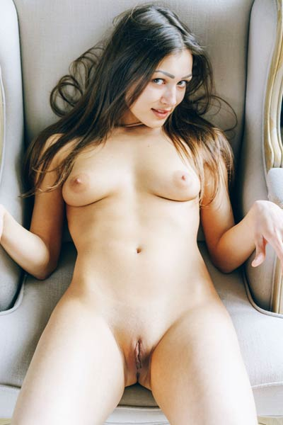 Sexy brunette Ariel poses naked in luxury chair showing off her gorgeous body