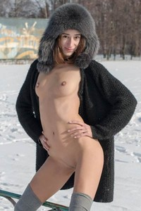 Cute Sugary poses naked on the snow showing of her sweet ass and perky tits