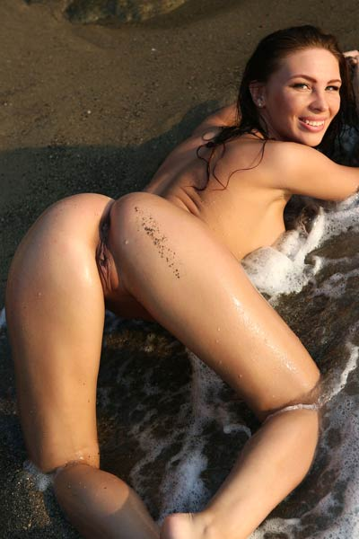 Astonishing brunette doll getting wet on her secret place by the sea