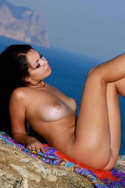 Top class model flashing with her amazing assets on the perfect view on the sea