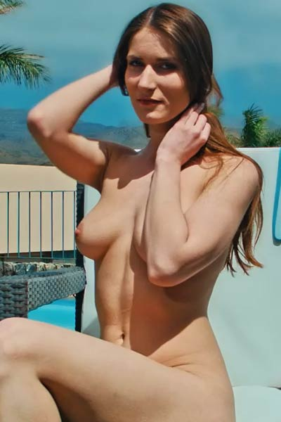 It is just a perfect day for Elina to please herself with nice masturbation on the poolside