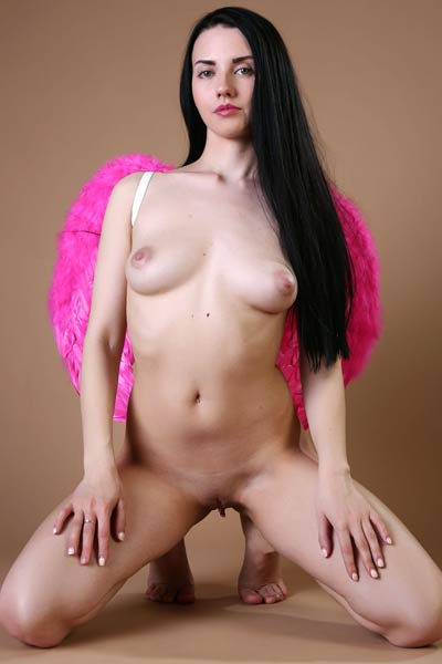 All naked all natural dark haired chick teasing in many different poses