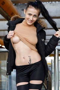 NIcole Love gets naked in public and she poses like she is addicted