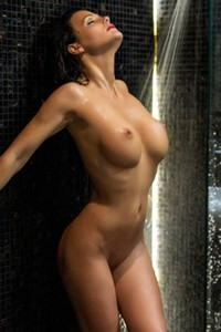 Get under the shower and spend some marvelous time with busty hottie in sexy red stockings