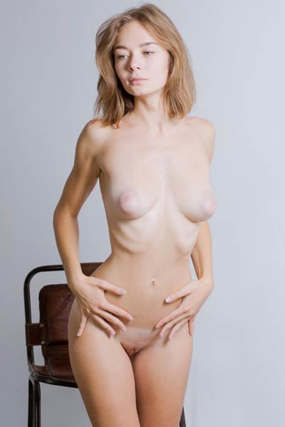 Blonde angel Madeline Y strips naked and gives us a glint of her love holes