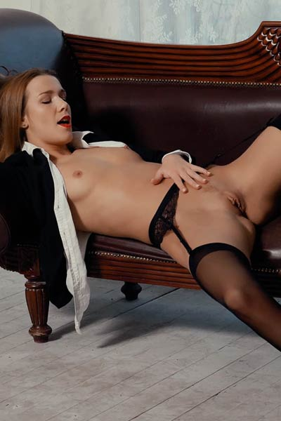 Alluring doll is on the leather sofa fingering her sweet shaved tasty pussy