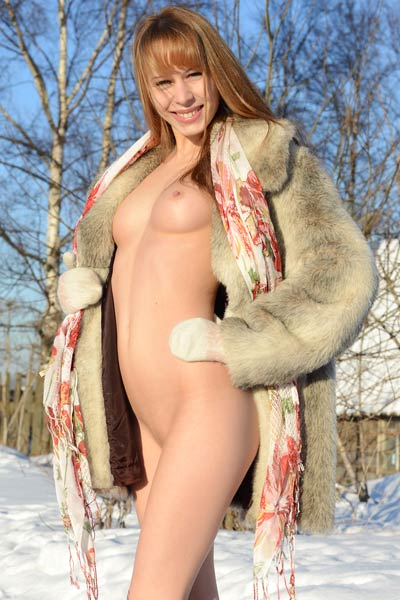 Angelic young babe poses naked on the snow showing off her perfect body