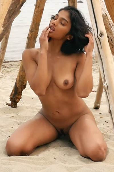 She is pretty she is sexy she is hot and she likes to spend her time on the beach in nude