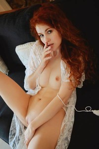 Foxy redhead babe Adel C slips away her lace nightie to show is her sex assets