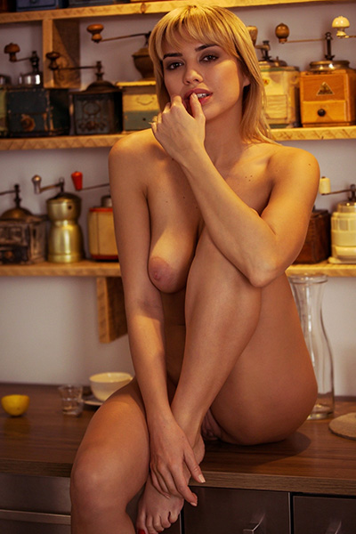 Margo Dumas goes wild in her sensual solo posing and undressing