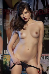 All natural vixen Shyla Jennings erotically poses in Magazine Wall