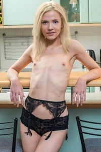 Delectable Camelia poses naked in the kitchen and dazzles us with her slender body
