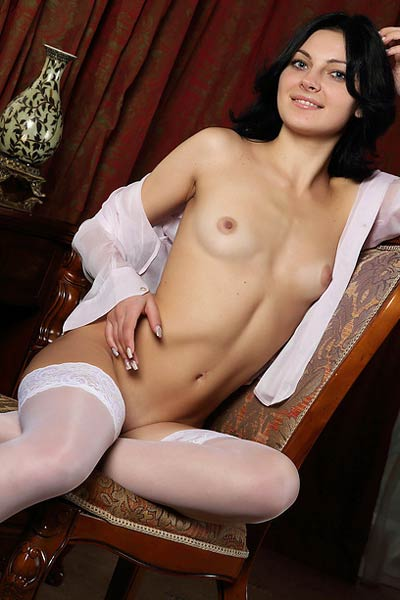Packed only in sexy white stockings naked Alna shows off her sexy natural body