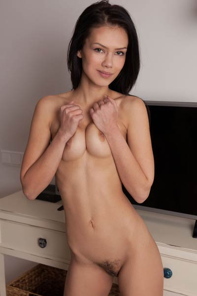 All natural goddess spins around and joyously shows off her hot unshaven pussy nice ass and tits