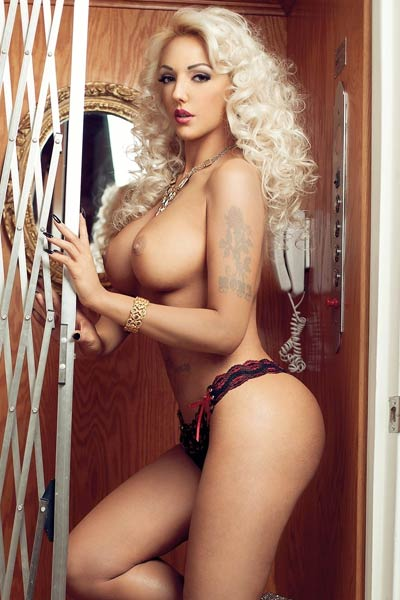 Busty blonde goddess Alexandra Harra makes your day much better with her hot photos