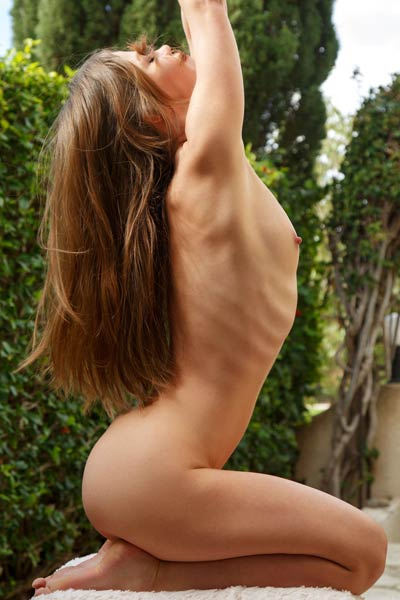 Seductive brunette Nedda A gently strips in the backyard baring her delectable naked body
