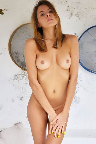 Good looking brunette with fine body Mango A will make you horny with only simple undressing