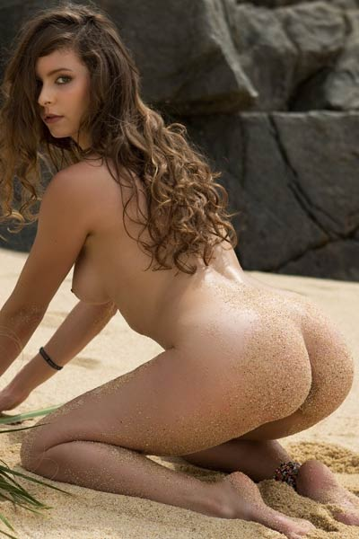 This is just another casual day at the beach for this hot brunette chick