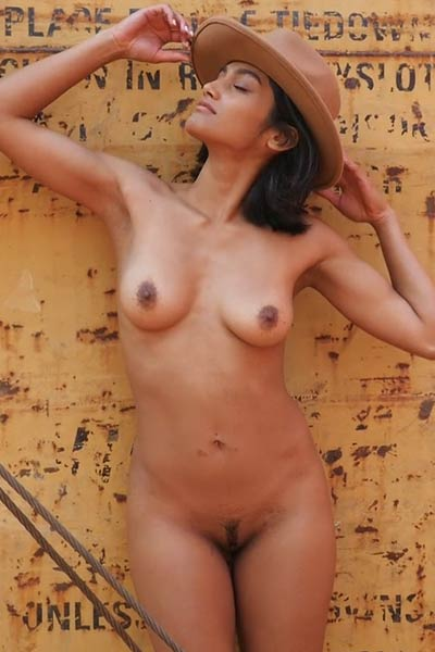 Astonishing young babe Angel Constance poses naked on the rails baring her magnificent tanned body