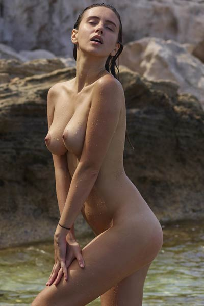Gorgeous Alisa shows her perfect boobs and shaved pussy as she poses in the sea