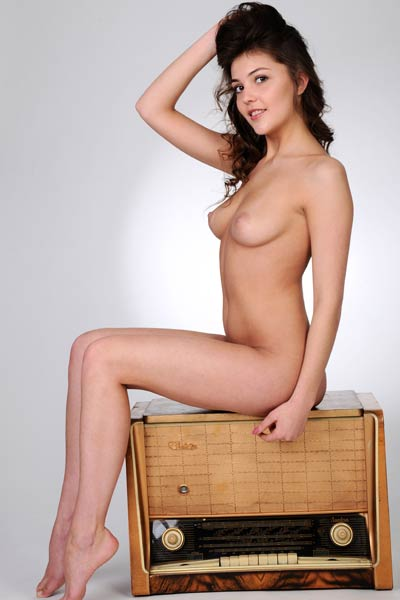 Charming brunette Lindsey T fills her loneliness with sensual undressing action
