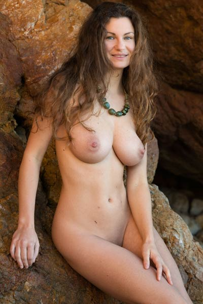 Big titted all natural brunette Susann poses naked on rocky beach
