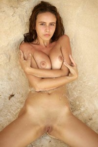 Astonishing Alisa poses naked on the sand baring her sweet assets