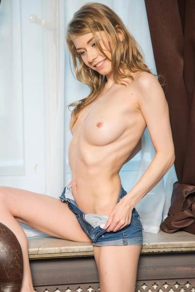 Cute blonde doll Eva Gold flaunts her sexy slender body