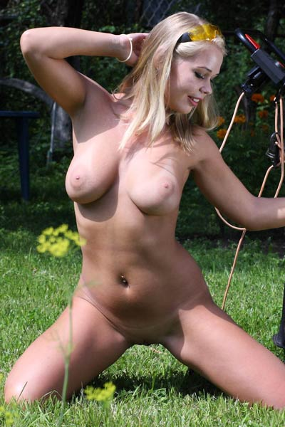 Well stacked blondie takes care of her backyard naked and horny