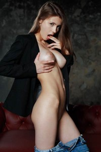 Mesmerizing doll Mila Azul seductively strips naked and exposes her gorgeous big boobs