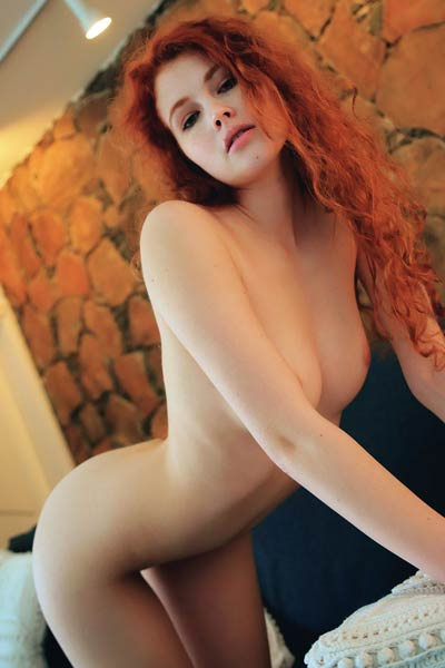 Redhead beauty Adel C bares a smoking hot body with delicious pussy