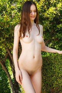 Cute brunette is not shy to show us her dazzling pussy and small tits