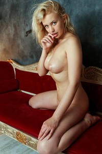 Superb young lady feels horny so she decided to get naked and to pose nicely