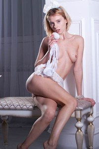 Sexy tall babe takes off her clothes and sets her slender naked body on fire