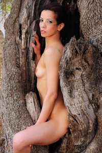 Astonishing young babe Valentina C poses naked by the tree and shows us he all natural body