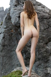 Big titted bomb with sweet face loves posing naked on rocks