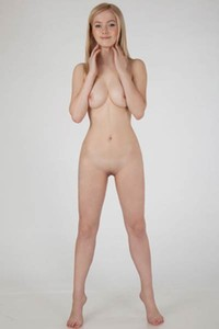 Blonde Lulya D sets her slender body on fire with sneusal posing skills