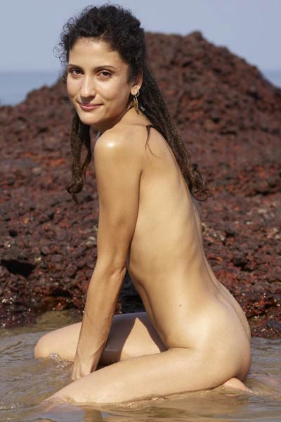 Sweet mermaid Serena L poses naked on the beach showing off her assets