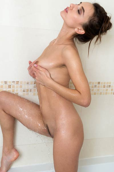 Irresistibly foxy babe takes hot shower and presents her astonishing body