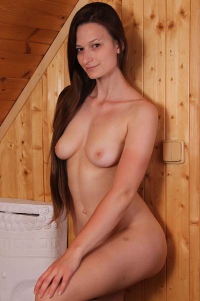 Elegant brunette Monna Dark is not shy at all to show us her perfect tight body