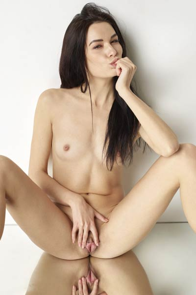 Astonishing Grace spreads her legs and shows us her meaty pussy