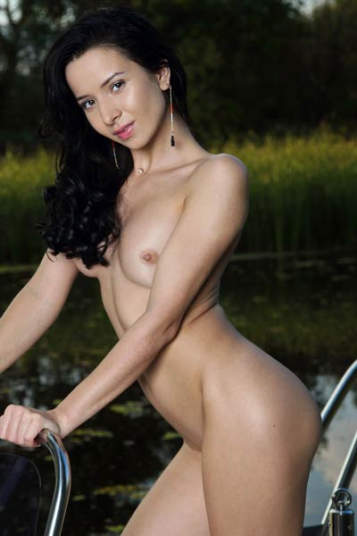 Beautiful dark haired babe Aurelia Perez poses naked on the boat baring her delightful body
