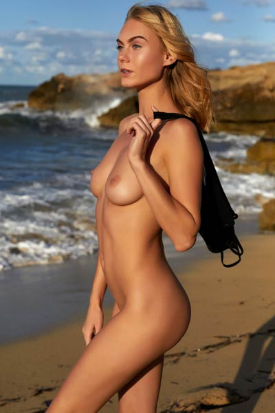 Nancy A beautiful blonde doll is alone on her secret beach posing naked for you