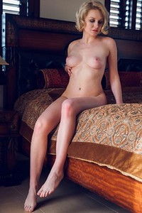 Short haired blonde Kery takes off her pink lingerie and poses nicely for you