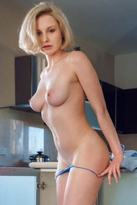 Irresistible blonde vixen Kery gets nude in kitchen and shows off her delightful body