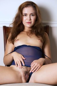 Amy horny brown haired chick removes her transparent bodysuit revealing hairy pussy