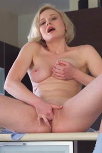 Beautiful short haired blonde Kery is all the way up in amazing undressing action