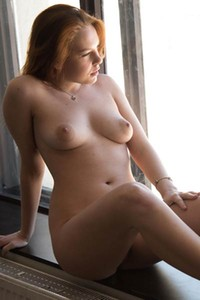 She is cute she owns sexy natural body and she likes to pose totally naked