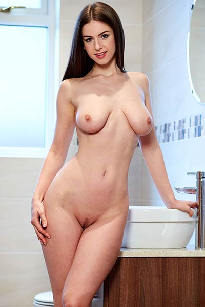 Big titted all natural brunette gets naked and leaves us speechless