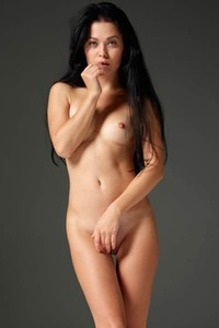Dark haired goddess takes off her bodysuit and flaunts her sexy tight body